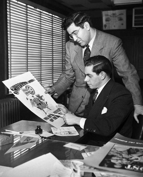 Jerry Siegel and Joe Shuster, seated, in their studio, ca. 1942. (Personal collection of Brad Ricca.)