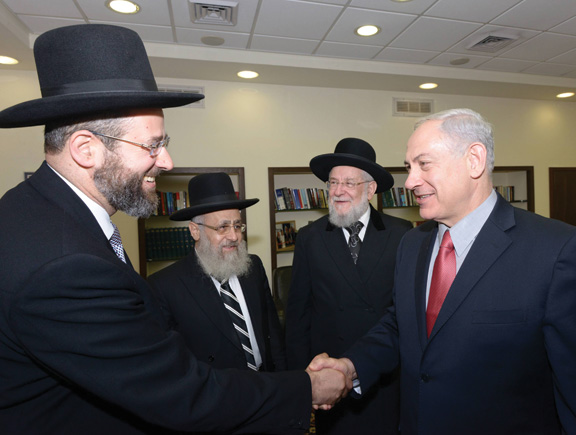 Newly elected chief rabbis, David Lau and Yitzhak Yosef, with Rabbi Israel Meir Lau and Benjamin Netanyahu. (Photo by Amos Ben Gershom, courtesy of the Government Press Office, Israel.)