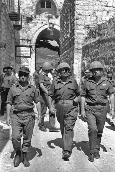 Defense Minister Moshe Dayan, with Uzi Narkis, left, and Chief of Staff  Yitzhak Rabin, right, enter Jerusalem, June 1967. (Photo by Ilan Bruner, courtesy of the Government Press Office, Israel.)