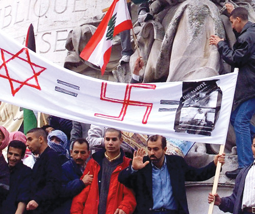 "French Muslims and Leftists demonstrate at the Place de la République, Paris, 2000. Cries of ""Death to the Jews"" were heard in a European capital for the first time since the Nazi period."