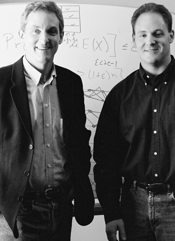 Tom Leighton and Lewin in front of one of the whiteboards they used to draft algorithms at MIT's Lab for Computer Science. (Courtesy of Chia Messina.)