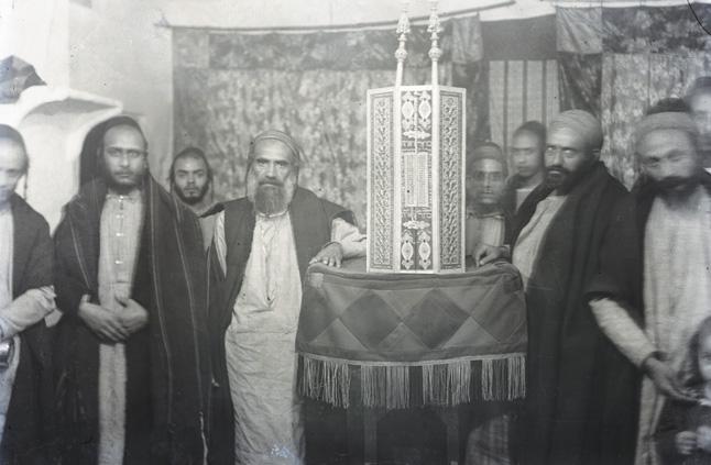 """Interior of the Al-Kissar Synagogue,"" showcasing its ornate Torah case."