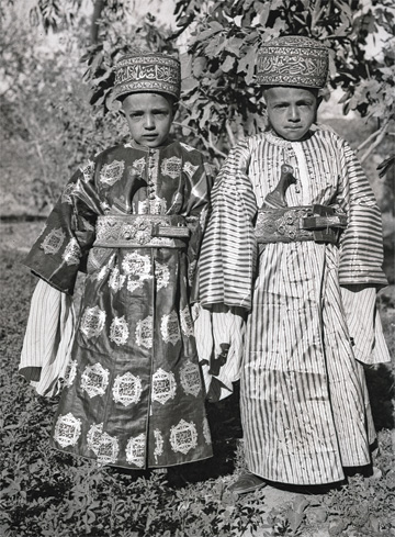 Two child princes wearing the regal attire attesting to their high rank.