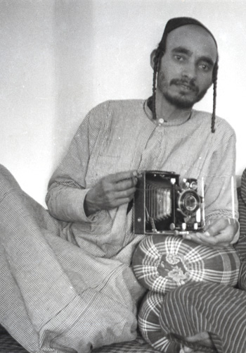 Yihye Haybi in a self-portrait with his camera