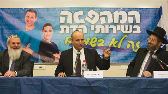 """From left: Rabbi Eli Ben-Dahan, Israel's Deputy Minister of Religious Affairs; Naftali Bennett, Minister of Religious Services; and Chief Rabbi David Lau at a press conference, February 2014. The banner behind them reads """"The Revolution in Religious Services."""" (Photo by Yonatan Sindel/Flash90.)"""