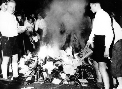 "Young Nazi party members and German youth destroy ""anti-German"" books in a public book burning, Berlin, May 1933. (Courtesy of Associated Press.)"