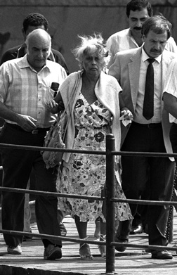 Marilyn Klinghoffer being escorted off the Achille Lauro three days after the murder of her husband, Leon, Port Said, Egypt, October 10, 1985. (© MikeNelson-Jean Claude Delmas/AFP/Getty Images.)