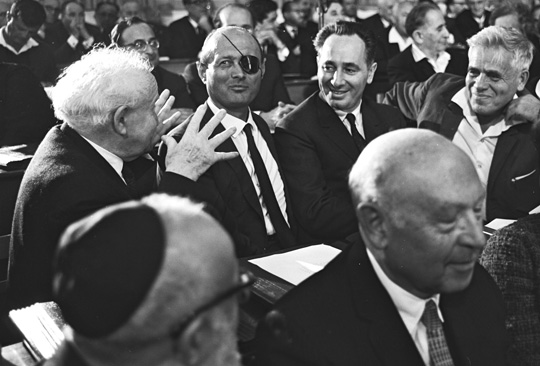 David Ben-Gurion with Moshe Dayan, Shimon Peres, and Ya'acov Hazan during the opening session of the 6thKnesset in Jerusalem.