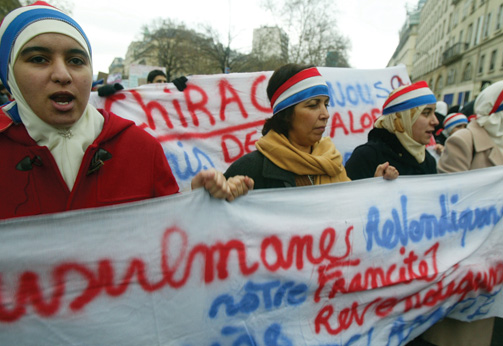 Muslim women demonstrate against the French proposal to ban the hijab, or headscarf, in state schools.
