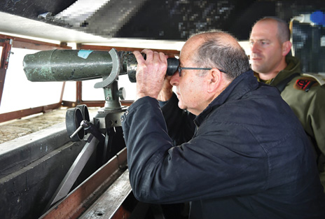 Israeli Defense Minister Moshe Ya'alon visits a military outpost on Mount Hermon.