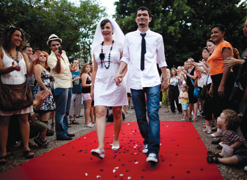 Yulia Tagil and Stas Granin celebrate their alternative wedding ceremony in a Tel Aviv square, July 2010, to protest the guidelines set by the Chief Rabbinate. (Photo by Uriel Sinai/Getty Images.)