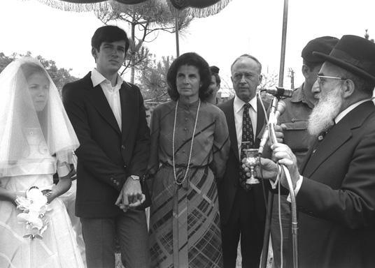 Chief Rabbi Shlomo Goren conducts the wedding ceremony of Yuval Rabin and his wife, Elat, Kfar Shmaryahu, May 18, 1976. (Photo by Yaacov Saar, courtesy of the Government Press Office, Israel.)