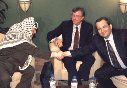 PLO leader Yasser Arafat, U.S. Middle East envoy Dennis Ross, and Israeli Prime Minister  Ehud Barak meet in the West Bank town of Ramallah, March 8, 2000, in a second attempt  to regenerate the Israeli-Palestinan peace talks. (AWAD AWAD/AFP/Getty Images.)