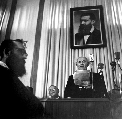 David Ben-Gurion at the ceremony of the declaration of the State of Israel, May 14, 1948. (Photo by Robert Capa, collection of the Tel Aviv Museum of Art. Photo: Elad Sarig.)