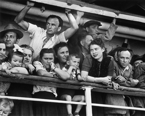 Immigrants arrive at the Haifa Port, ca. 1949–1950. (© Robert Capa, © International Center of Photography/Magnum Photos.)