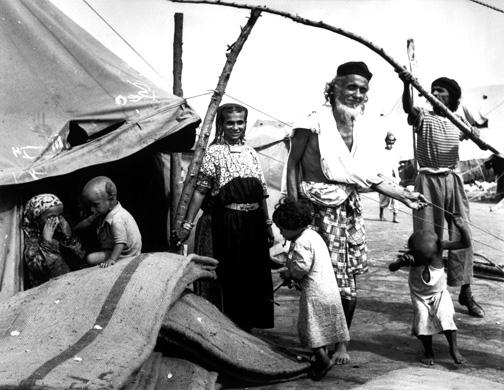 Immigrant transit camp, ca. 1949–1950. (© Robert Capa, © International Center of Photography/Magnum Photos.)
