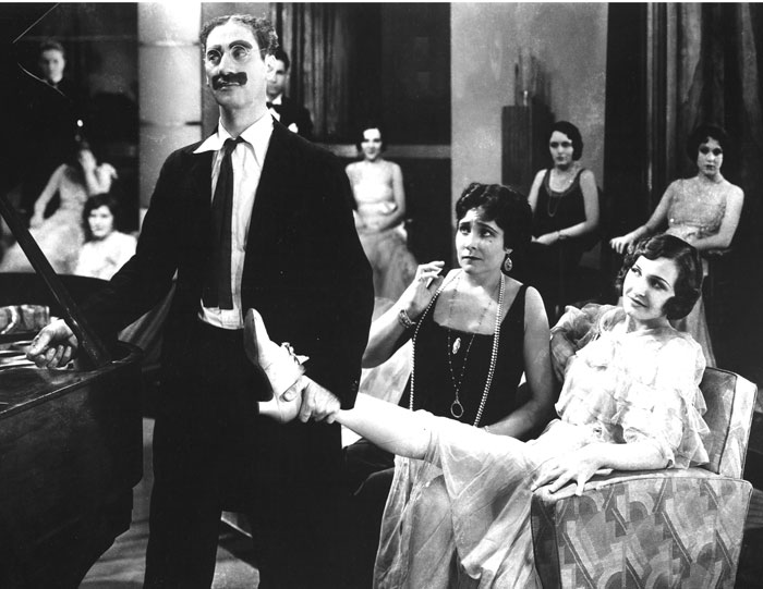 Groucho Marx as Captain Jeffrey Edgar Spaulding with Margaret Dumont, right, in a scene from Animal Crackers, 1930. (Courtesy of the Everett Collection.)