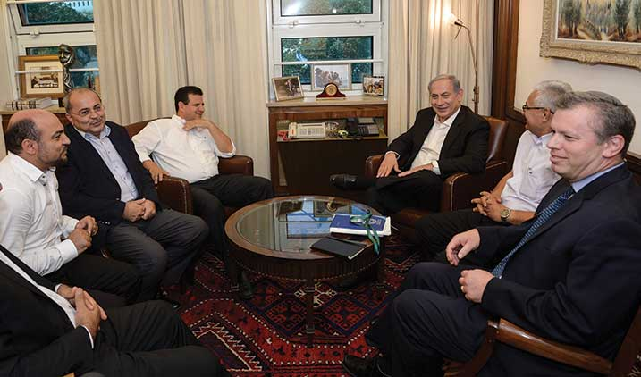 Prime Minister Benjamin Netanyahu with representatives of the Arab Joint List party discussing growing  budgets for Arab councils and municipalities, Jerusalem, August 31, 2015. (Photo by Amos Ben  Gershom/GPO/Flash90.)