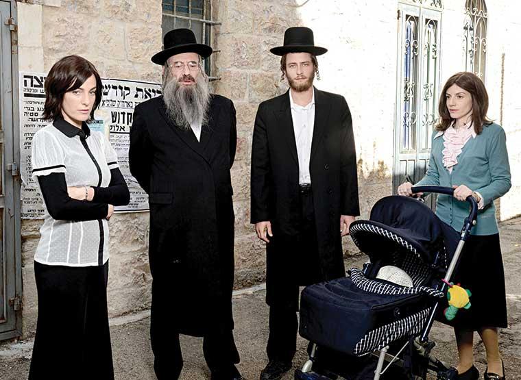 The fictional haredi family living in Jerusalem's Mea Shearim neighborhood. From left, Elisheva  (Ayelet Zurer), Reb Shulem Shtisel (Doval'e Glickman), Akiva(Michael Aloni),and Giti (Neta Riskin).  (Courtesy of Shtisel and Go2Films.)