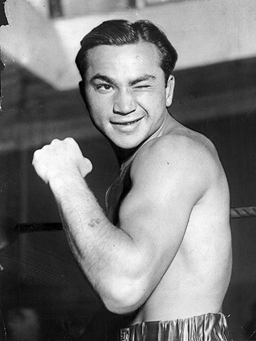 Portrait of professional boxer Barney Ross, 1950. (© Chicago History Museum/Getty Images.)