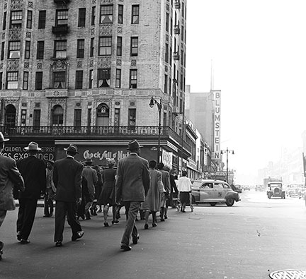 Pedestrian traffic near 125th Street, Harlem, 1948. The sign for Blumstein's department store is visible in the distance. (Photo by Rae Russel/Getty Images.)