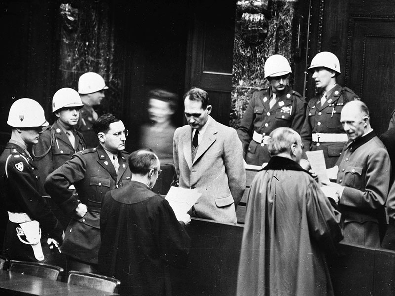 Captain Gustave Mark Gilbert, Nuremberg trials psychologist, observes Rudolf Hess, who had  claimed amnesia, 1945. (Photo by Roger Viollet/Getty Images.)