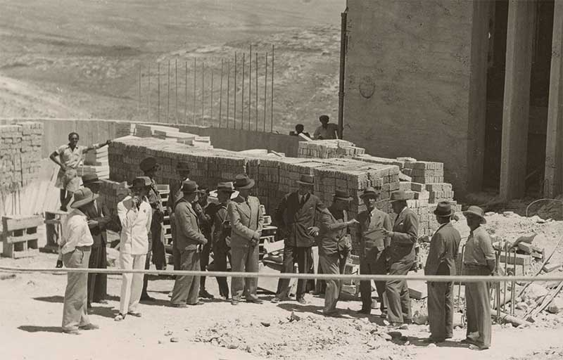 Erich Mendelsohn (fifth from right) at the building site of the Hadassah Hospital, Jerusalem, ca. 1937.  (Courtesy of The Getty Research Institute, Los Angeles.)