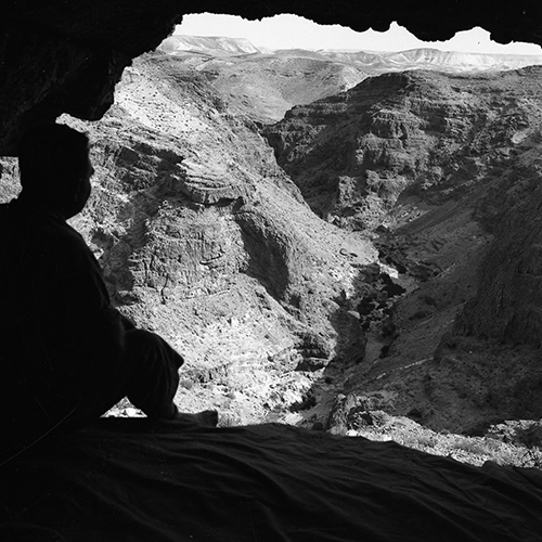 Photo of a view from a cave opening.