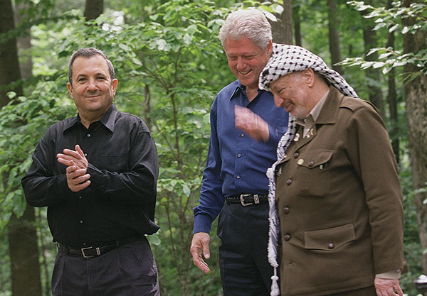 Photo of Prime Minister Ehud Barak, President Bill Clinton, and PLO Chairman Yasser Arafat at the opening of the Camp David summit.