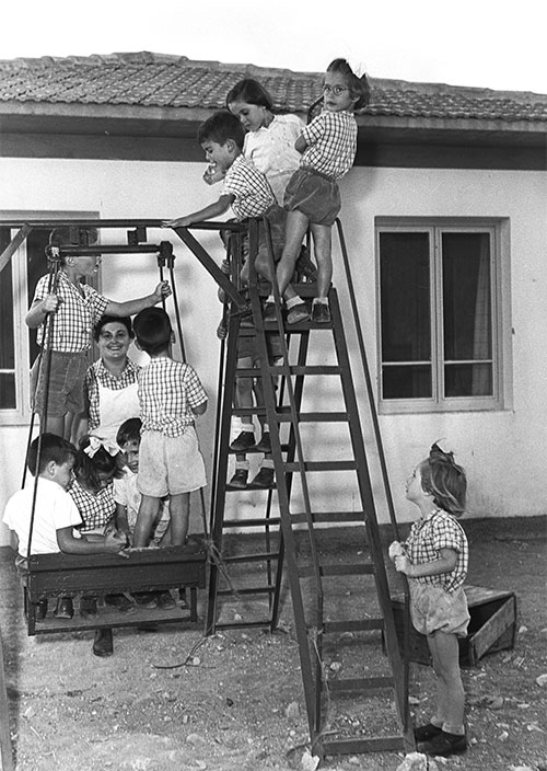 Children playing in front of a house