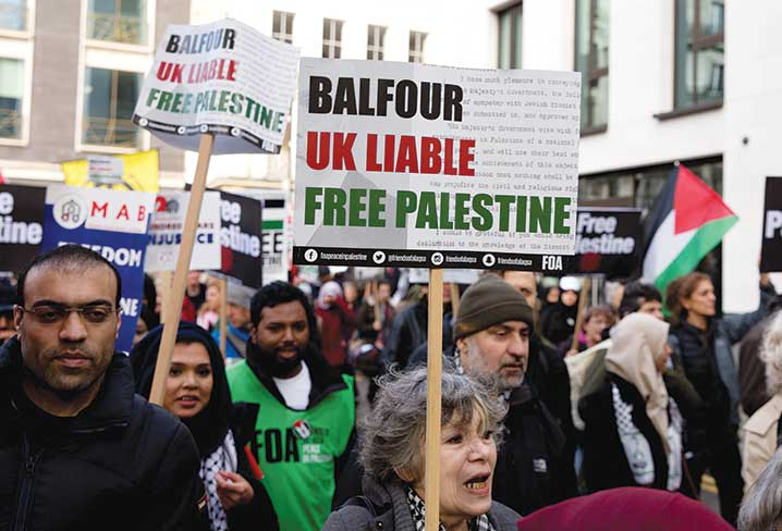 Palestinian supporters march through central London