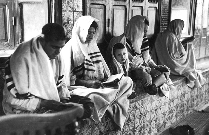 Photo of Jewish people sitting at synagogue