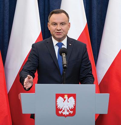 Polish President Andrzej Duda speaking behing a podium.