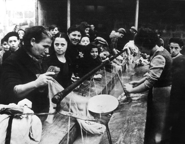 Black and white photo of Jewish women doing laundry