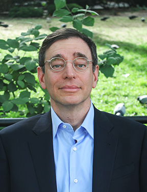 Photograph of Seth M. Siegel, looking at the camera.