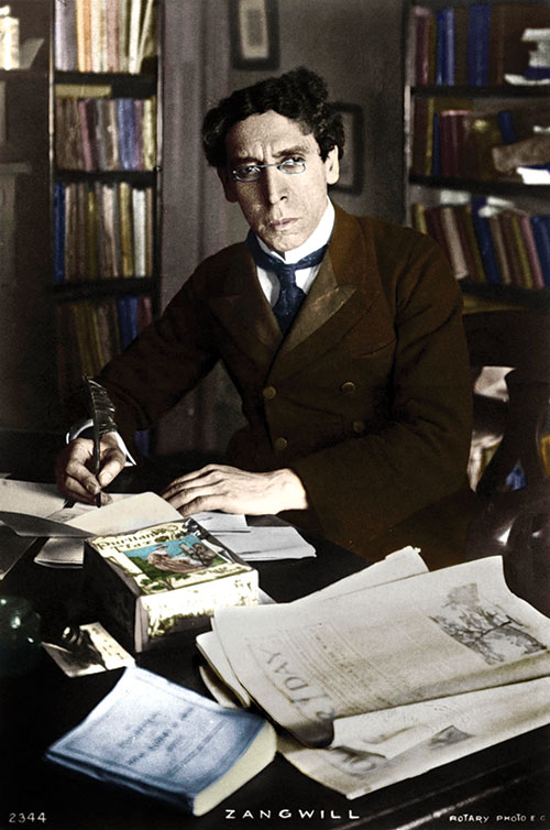 Photo of Israel Zangwill sitting in library with books.