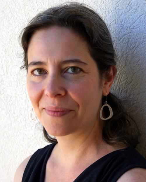 Head shot of Jessica Cohen, smiling toward the camera.