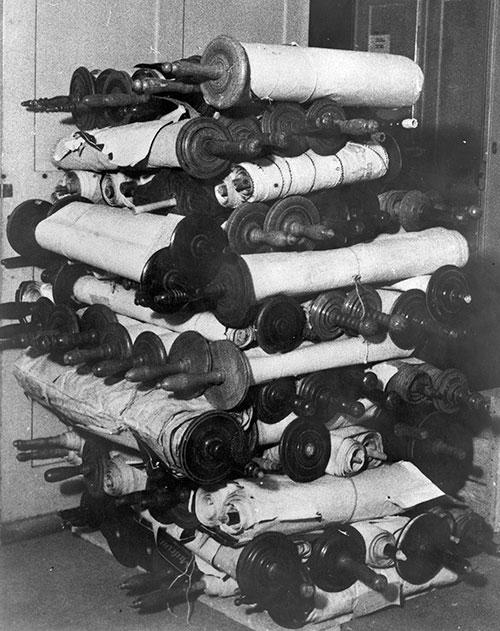 Photo of a stack of Torah scrolls