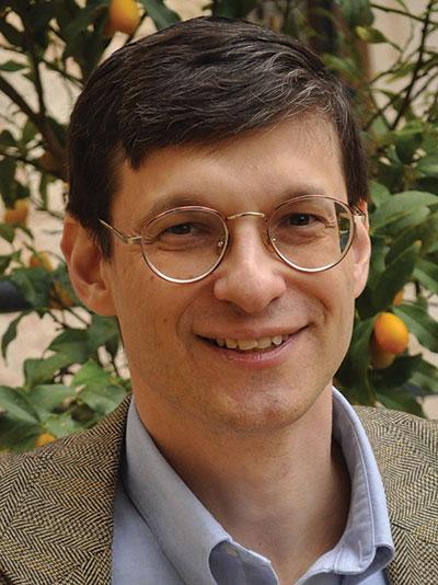 Headshot of a gentleman wearing glasses