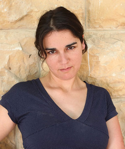 Author photo of a young woman with dark hair pulled back