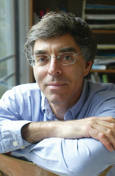 Author photo of Daniel C. Matt, sitting with arms crossed wearing glasses