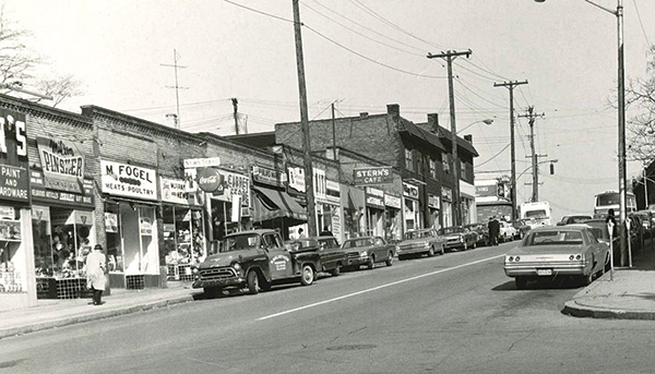 Black and white vintage photo of Murray Avenue storefronts