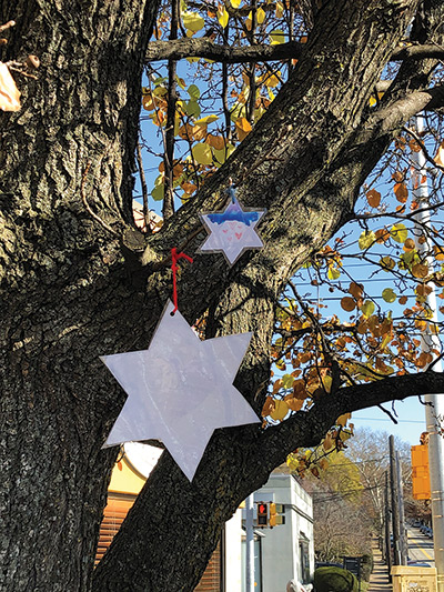 Stars of David hanging from a tree