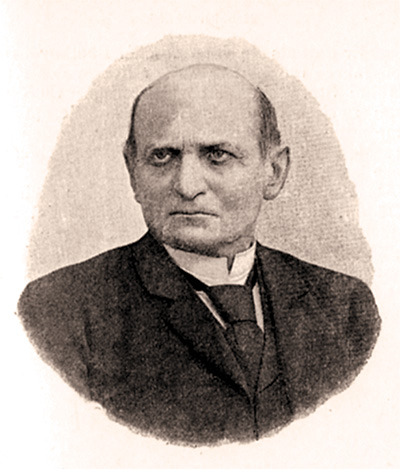 Black and white photo of a balding man in a shirt and tie