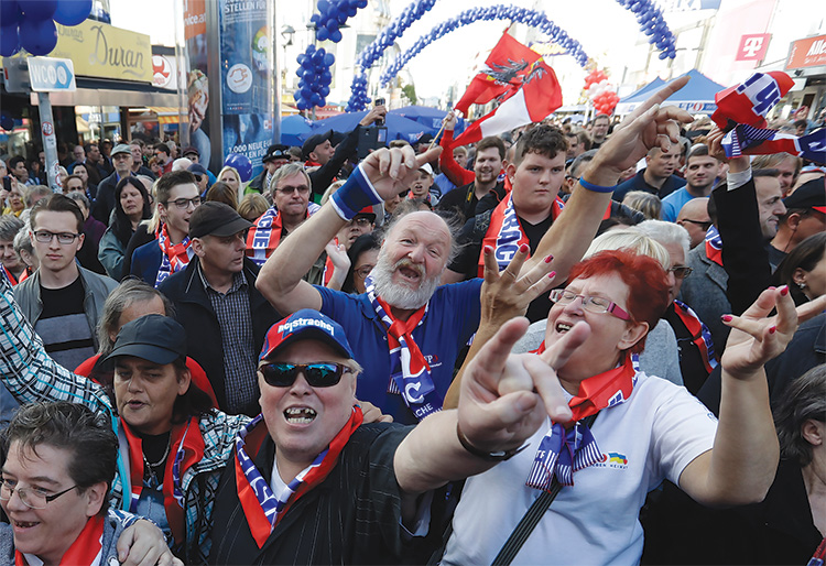 Crowd shot of supporters of the Austrian Freedom Party dressed in patriotic gear