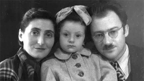Black and white photograph of two parents with their little girl