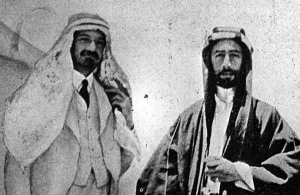 Black and white photo of two men in Arab dress