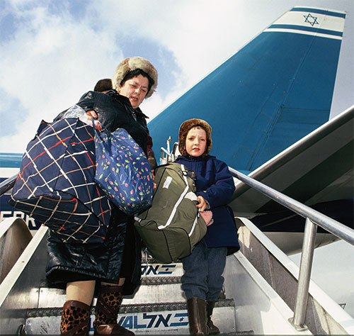 Russian immigrants arrive in Israel debarking from an El Al flight in the early 1990s.