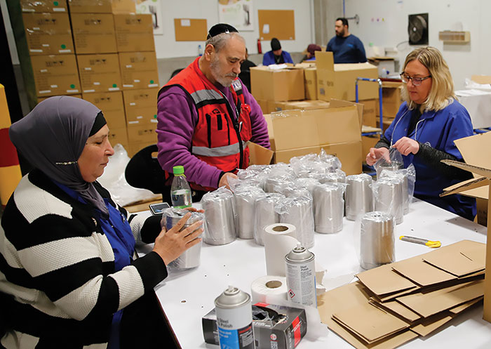Jewish and Bedouin employees work together in the SodaStream factory in the Bedouin city of Rahat, Negev, February 18, 2019.