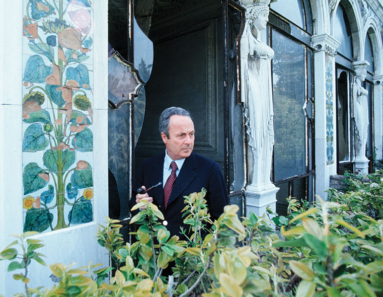 Giorgio Bassani holding a pipe at the Villa Blanc, ruined by decay and neglect, Rome, May 1974.